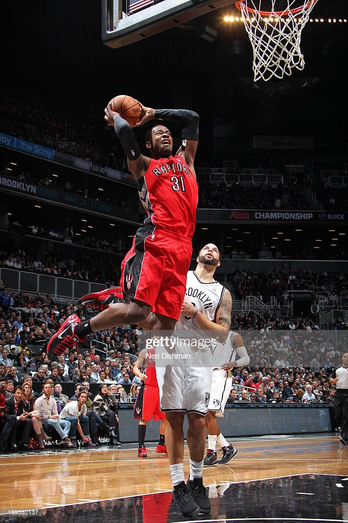 Terrence Ross #31 of the Toronto Raptors rises for a dunk against Deron Williams #8 of the Brooklyn Nets at the Barclays Center on January 15, 2013 in the Brooklyn borough of New York City in New York City.