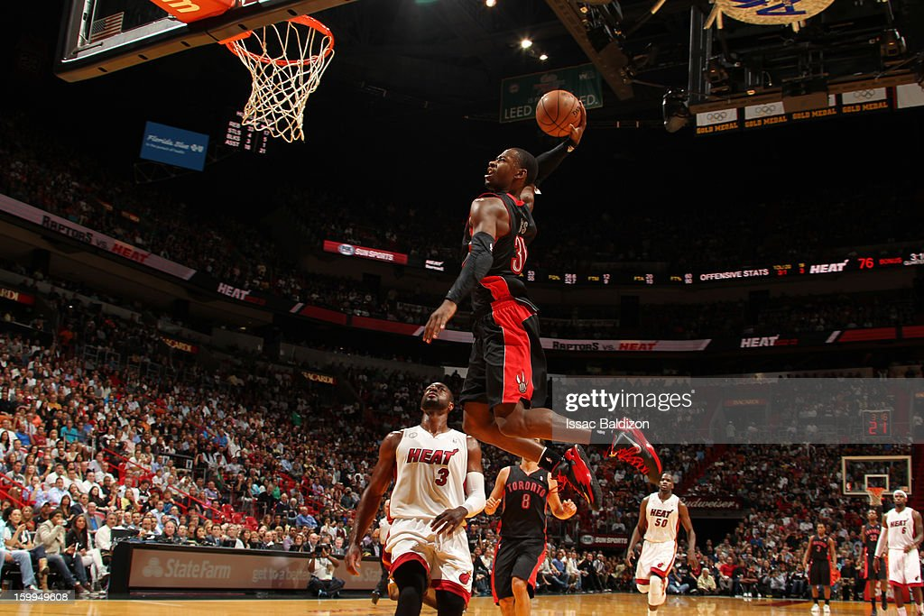 Terrence Ross #31 of the Toronto Raptors rises for a dunk against Dwyane Wade #3 of the Miami Heat on January 23, 2013 at American Airlines Arena in Miami, Florida.