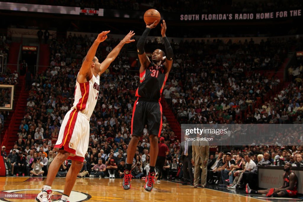 Terrence Ross #31 of the Toronto Raptors shoots a jumper against Shane Battier #31 of the Miami Heat on January 23, 2013 at American Airlines Arena in Miami, Florida.