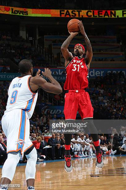 Terrence Ross of the Toronto Raptors shoots against Serge Ibaka of the Oklahoma City Thunder during the game on November 4 2015 at Chesapeake Energy...
