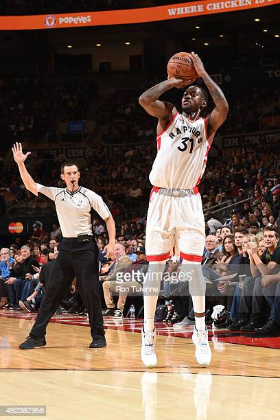 Terrence Ross of the Toronto Raptors shoots against the Minnesota Timberwolves on October 12 2015 at the Air Canada Centre in Toronto Ontario Canada...