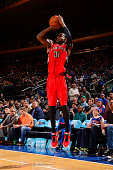 Terrence Ross of the Toronto Raptors takes a shot against the New York Knicks during a game at Madison Square Garden on October 13 2014 in New York...