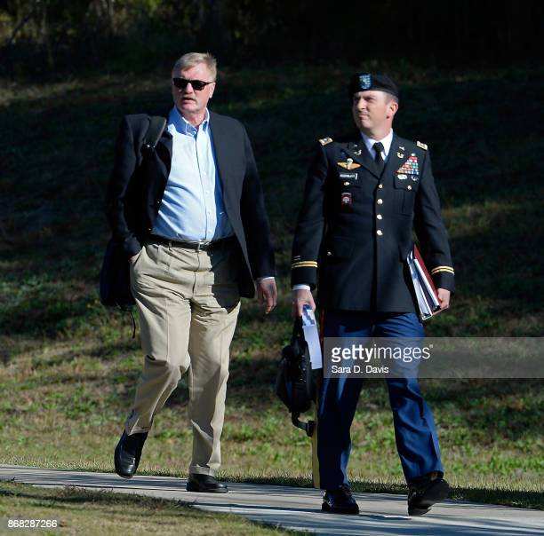 Terrence Russell of the Pentagon's Joint Personnel Recovery Agency and Army Lt Col Franklin D Rosenblatt leave the Ft Bragg military courthouse...