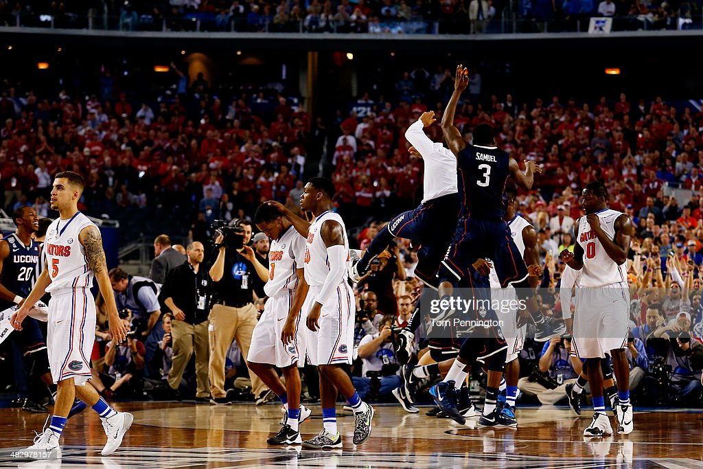 Terrence Samuel #3 and the Connecticut Huskies celebrate after defeating the Florida Gators 63-53 in the NCAA Men's Final Four Semifinal at AT&T Stadium on April 5, 2014 in Arlington, Texas.