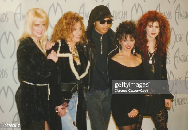 Terrence Trent D'Arby and members of The Bangles female pop rock group posing on stage San Francisco California 1987
