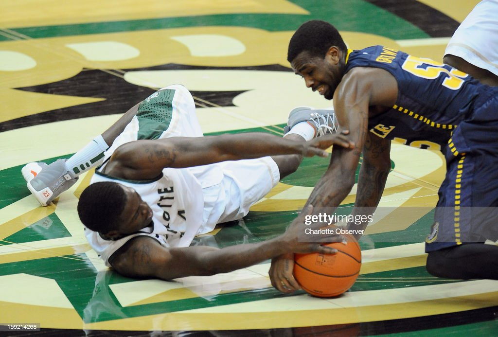Terrence Williams and La Salle's (55) Ramon Galloway fight for control of a loose ball during first-half action on Wednesday, January 9, 2013, at Halton Arena in Charlotte, North Carolina.