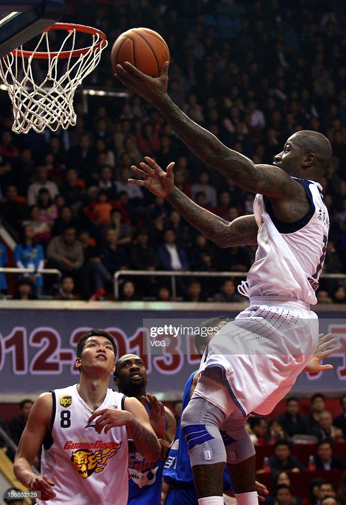 <a gi-track='captionPersonalityLinkClicked' href=/galleries/search?phrase=Terrence+Williams&family=editorial&specificpeople=666450 ng-click='$event.stopPropagation()'>Terrence Williams</a> #1 of Guangdong Southern Tigers drives to the basket during the 11th round of the CBA 12/13 game against Shanghai Sharks at Dongguan Stadium on December 18, 2012 in Donggang, China.