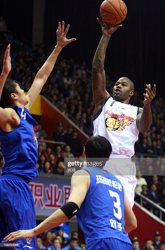 <a gi-track='captionPersonalityLinkClicked' href=/galleries/search?phrase=Terrence+Williams&family=editorial&specificpeople=666450 ng-click='$event.stopPropagation()'>Terrence Williams</a> #1 of Guangdong Southern Tigers shoots the ball during the 11th round of the CBA 12/13 game against Shanghai Sharks at Dongguan Stadium on December 18, 2012 in Donggang, China.