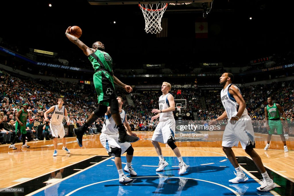 <a gi-track='captionPersonalityLinkClicked' href=/galleries/search?phrase=Terrence+Williams&family=editorial&specificpeople=666450 ng-click='$event.stopPropagation()'>Terrence Williams</a> #55 of the Boston Celtics rises for a dunk against the Minnesota Timberwolves on April 1, 2013 at Target Center in Minneapolis, Minnesota.