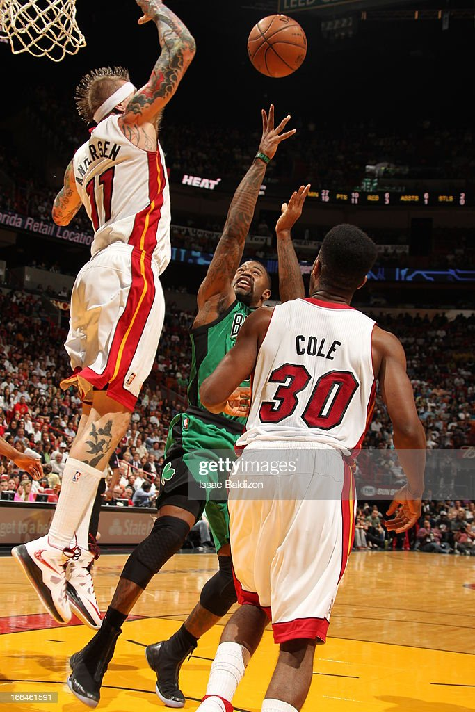 <a gi-track='captionPersonalityLinkClicked' href=/galleries/search?phrase=Terrence+Williams&family=editorial&specificpeople=666450 ng-click='$event.stopPropagation()'>Terrence Williams</a> #55 of the Boston Celtics shoots against Chris Andersen #11 of the Miami Heat on April 12, 2013 at American Airlines Arena in Miami, Florida.