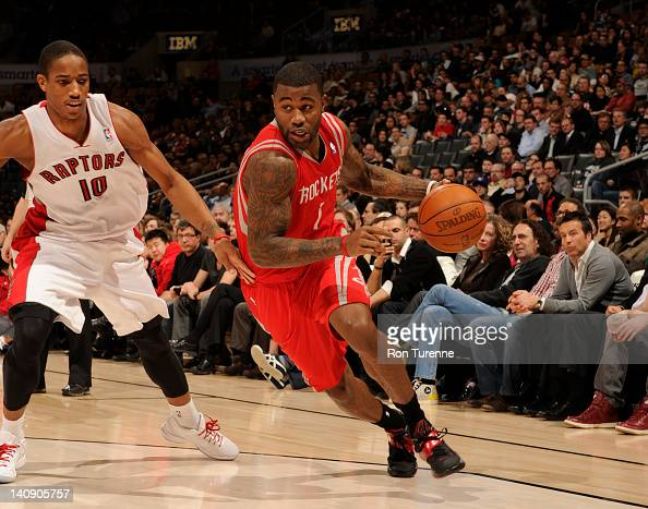 Terrence Williams of the Houston Rockets drives around DeMar DeRozan of the Toronto Raptors during the game between the Toronto Raptors and the...