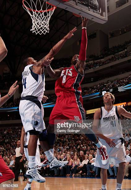 Terrence Williams of the New Jersey Nets goes up for the layup against Caron Butler of the Dallas Mavericks during a game at the American Airlines...