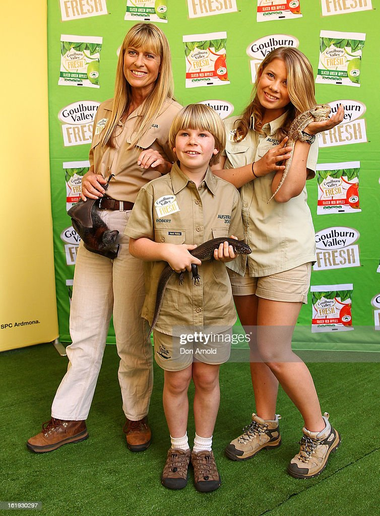 Terri Irwin, Robert Irwin and Bindi Irwin pose with a bat and some lizards during the Goulburn Valley Fresh launch at Martin Place on February 18, 2013 in Sydney, Australia.