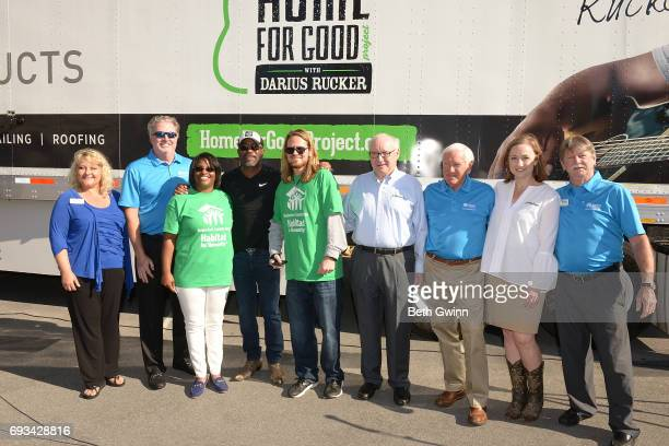 Terri Schultz John Floyd Shari Hinton Darius Rucker Charles Russell Chairman and CEO of Ply Gem Gary E Robinette CEO Vickie Frye and Tom Gipson pose...