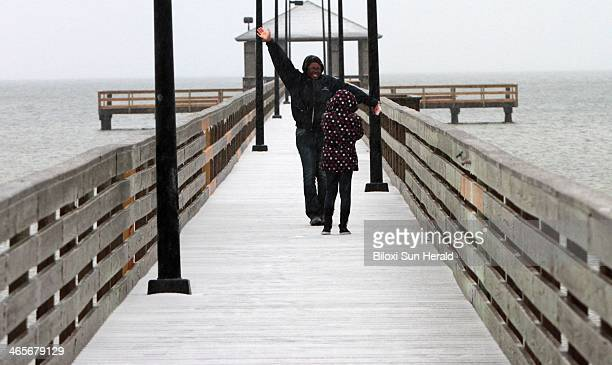 Terri White poses for a photo for her eightyearold daughter Demilion Harris on the Lighthouse Pier in Biloxi Miss on Tuesday Jan 28 2014 Frozen rain...