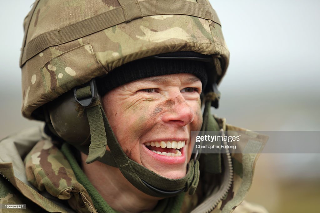 Territorial Army gunner Louisa Smith of the Royal Artillery shares a joke with her comrades during an exercise on February 20, 2013 in Otterburn, United Kingdom. Artillery units from Brtain and France are taking part in an intensive training exercise for Regular and Reserve Army units preparing for Afghanistan at the Otterburn training area in Northumberland. French Fire Support Teams, who work alongside their infantry units calling in artillery support, are learning to work with the Royal Artillery for future combat.
