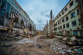 Territory of abandoned industrial area waiting for demolition. Junk at former Voronezh excavator factory.