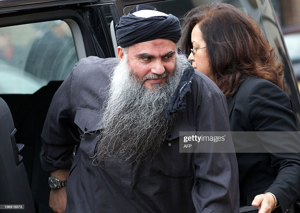 Terror suspect Abu Qatada arrives at his home in northwest London on November 13, 2012, after he was released from prison. Britain released the radical Islamist preacher from prison on bail after judges ruled that the man dubbed Osama bin Laden's right-hand man in Europe should not be extradited to Jordan. AFP PHOTO / ANDREW COWIE
