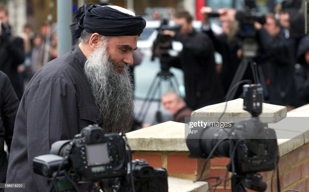 Terror suspect Abu Qatada arrives at his home in northwest London on November 13, 2012, after he was released from prison. Britain released the radical Islamist preacher from prison on bail after judges ruled that the man dubbed Osama bin Laden's right-hand man in Europe should not be extradited to Jordan.