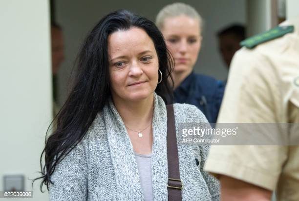 Terror suspect Beate Zschaepe arrives at a courtroom as her trial continues at the higher regional court in Munich southern Germany on July 25 2017...