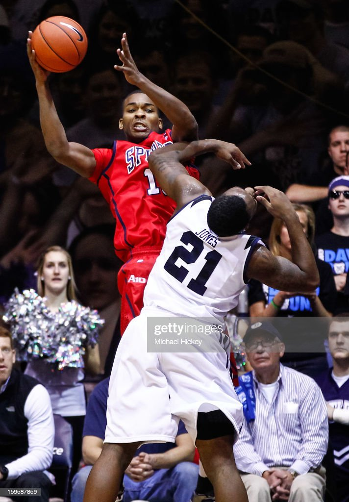 Terry Allen #15 of the Richmond Spiders catches a pass as Roosevelt Jones #21 of the Butler Bulldogs defends at Hinkle Fieldhouse on January 16, 2013 in Indianapolis, Indiana. Butler defeated Richmond 62-47.