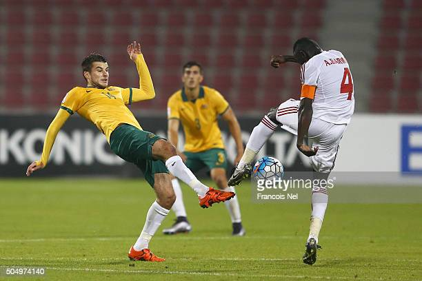 Terry Antonis of Australia and Ahmed Barman of the United Arab Emirates battle for the ball during the AFC U23 Championship Group D match between...