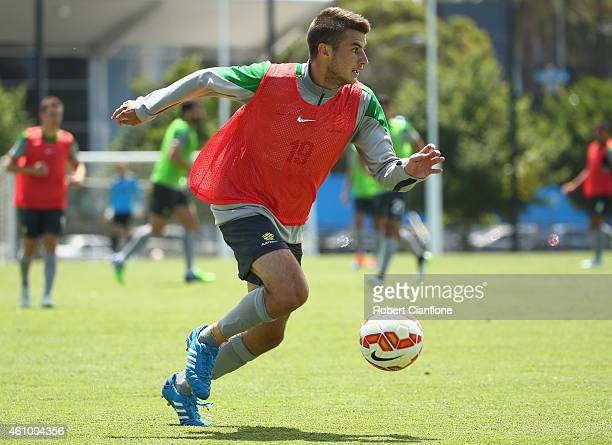 Terry Antonis of Australia looks up field during an Australian Socceroos training session at Collingwood training Ground on January 4 2015 in...