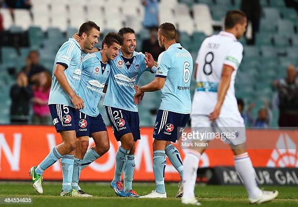 Terry Antonis of Sydney celebrates scoring a goal with team mates during the round 27 ALeague match between Sydney FC and Perth Glory at Allianz...