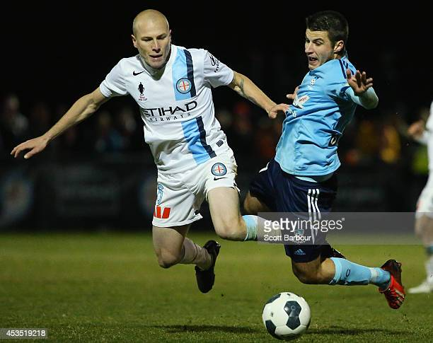 Terry Antonis of Sydney FC and Aaron Mooy of City compete for the ball during the FFA Cup match between Melbourne City and Sydney FC at Morshead Park...