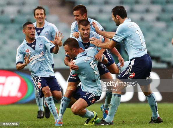 Terry Antonis of Sydney FC celebrates with team mates after scoring their second goal during the round 19 ALeague match between Sydney FC and Perth...