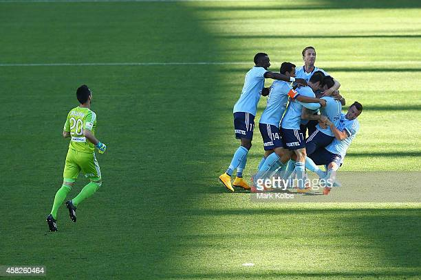 Terry Antonis of Sydney FC is congratulated by his team mates after scoring a goal during the round four ALeague match between Sydney FC and the...