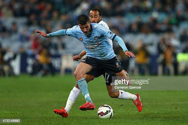 Terry Antonis of Sydney FC is tackled by Andros Townsend of Hotspur during the international friendly match between Sydney FC and Tottenham Spurs at...