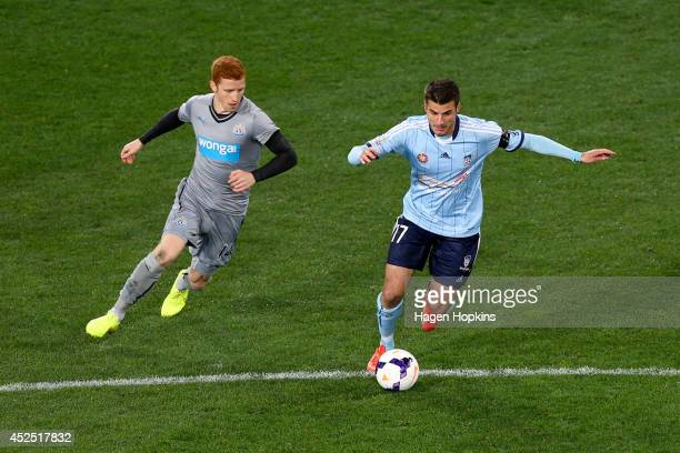 Terry Antonis of Sydney FC runs the ball under pressure from Jack Colback of Newcastle United during the international friendly match between...