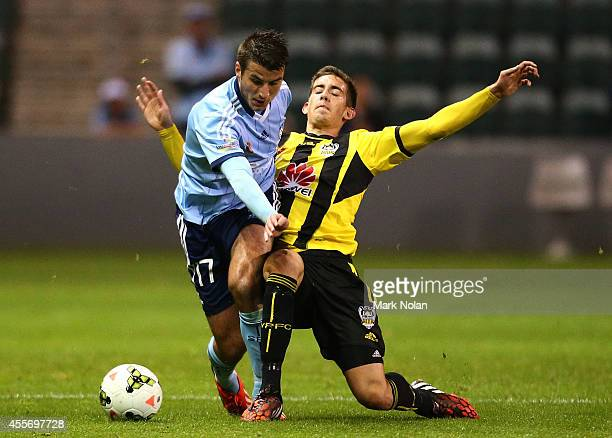 Terry Antonis of Sydney is tackled by Alex Rodriguez of the Phoenix during the ALeague preseason match between Sydney FC and the Wellington Phoenix...