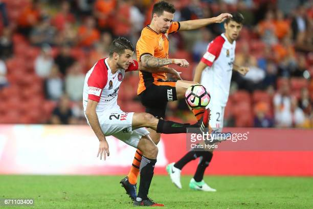Terry Antonis of the Wanderers and Jamie Maclaren of the Roar compete for the ball during the ALeague Elimination Final match between the Brisbane...