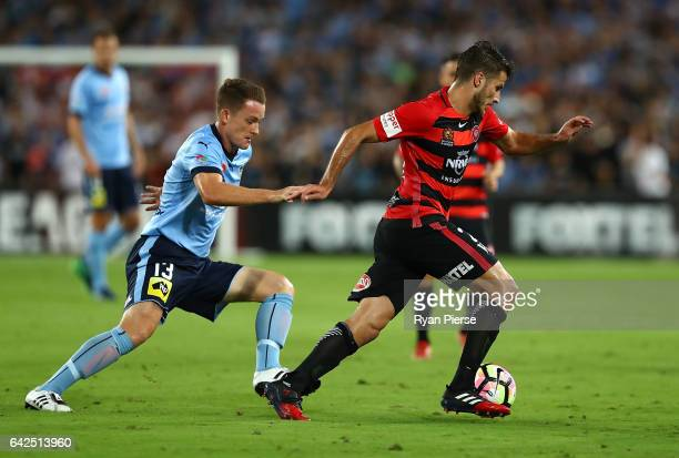 Terry Antonis of the Wanderers clears the ball from Brandon O'Neill of Sydney FC during the round 20 ALeague match between the Western Sydney...