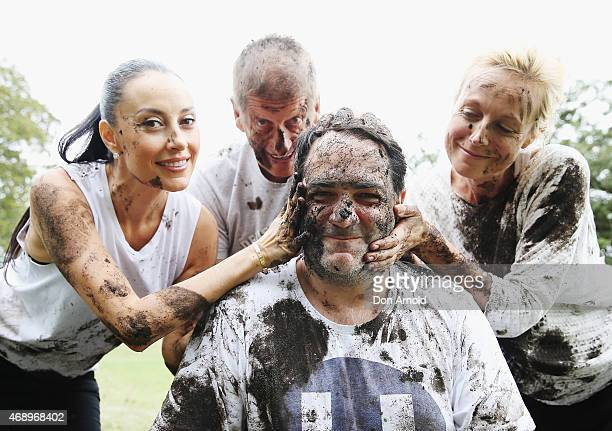 Terri Biviano Greig Pickhaver Michael Wipfli and Marta Dusseldorp pose after participating in a mud fight to raise awareness about the 'Mud Pie...