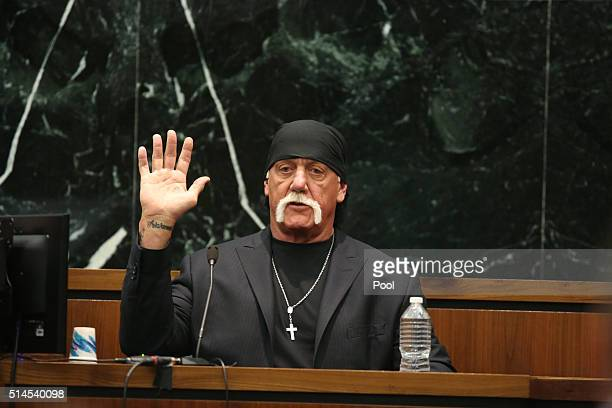 OUT Terry Bollea aka Hulk Hogan takes the oath in court during his trial against Gawker Media at the Pinellas County Courthouse on March 8 2016 in St...
