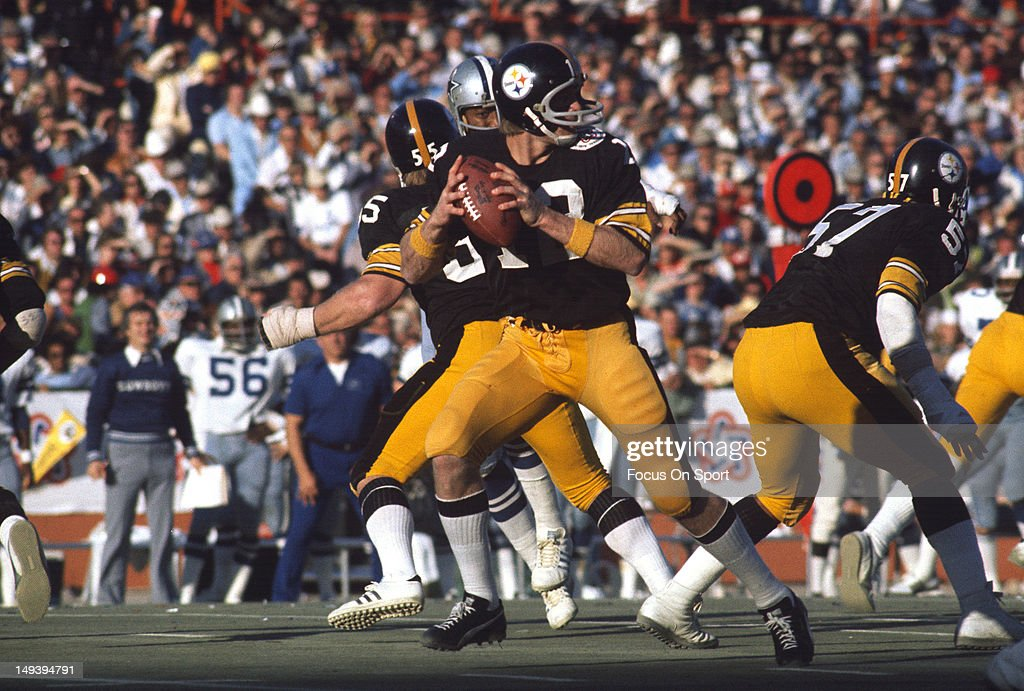 Terry Bradshaw #12 of the Pittsburgh Steelers drops back to pass against the Dallas Cowboys during Super Bowl X on January 18, 1976 at the Orange Bowl in Miami, Florida. The Steelers won the Super Bowl 21-7.