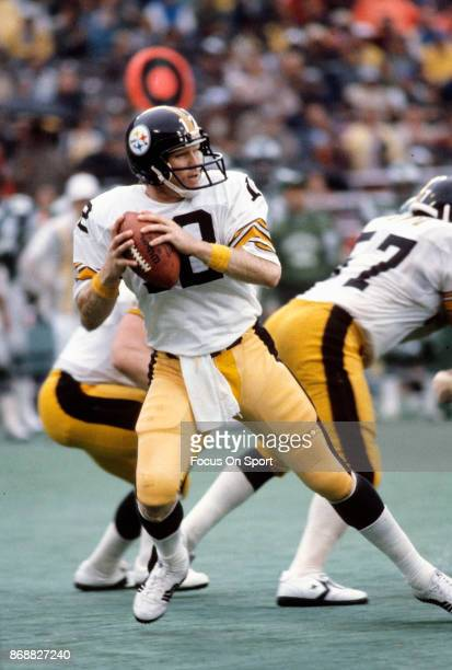 Terry Bradshaw of the Pittsburgh Steelers drops back to pass against the Philadelphia Eagles during an NFL football game September 30 1979 at...