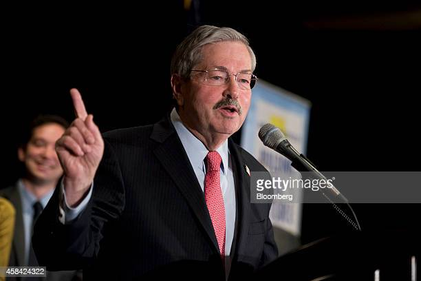 Terry Branstad governor of Iowa speaks at an election night rally with Joni Ernst newly elected Iowa Republican for US Senate not pictured in West...