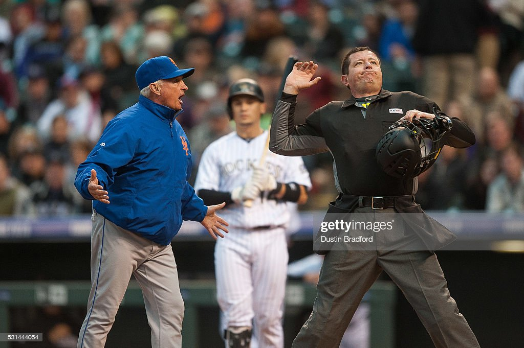 Terry Collins #10 of the New York Mets is thrown out of the game by umpire Carlos Torres after arguing that Tony Wolters #14 of the Colorado Rockies was out with a strike out in the third inning of a game at Coors Field on May 14, 2016 in Denver, Colorado.