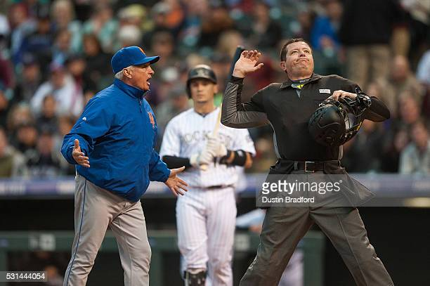 Terry Collins of the New York Mets is thrown out of the game by umpire Carlos Torres after arguing that Tony Wolters of the Colorado Rockies was out...