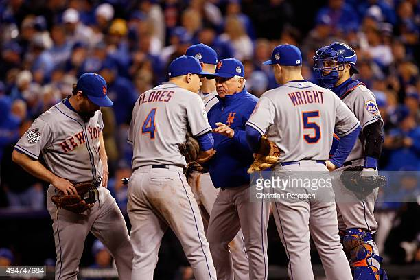 Terry Collins of the New York Mets visits the pitcher's mound in the eighth inning in Game Two of the 2015 World Series between the Kansas City...