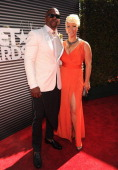 Terry Crews and Rebecca KingCrews attend the BET AWARDS '14 at Nokia Theatre LA LIVE on June 29 2014 in Los Angeles California