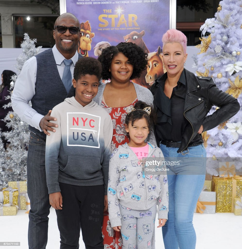 Terry Crews, Rebecca King-Crews and kids arrive at the premiere of Columbia Pictures' 'The Star' at Regency Village Theatre on November 12, 2017 in Westwood, California.