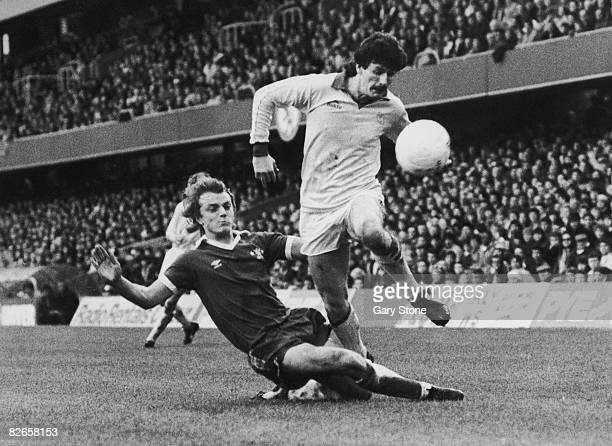 Terry Curran of Sheffield Wednesday steps over John Bumstead of Chelsea during a Second Division match at Stamford Bridge London 22nd November 1980