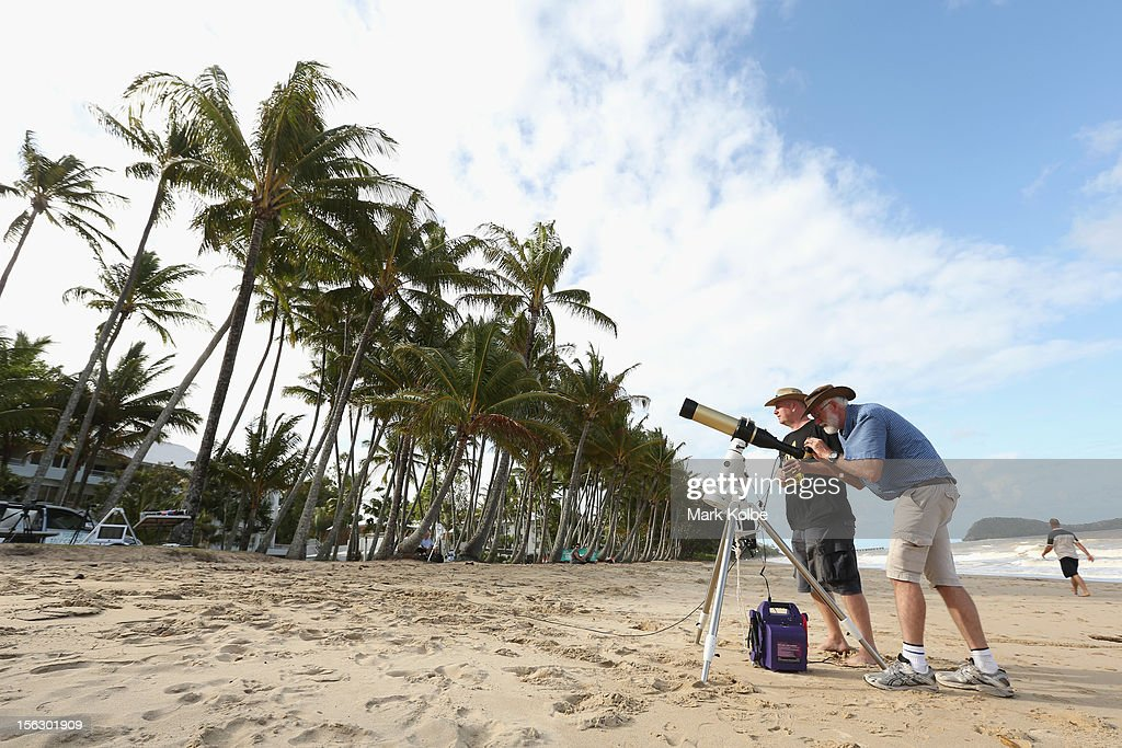 Terry Cuttle sets up telescopic cameras and computer equipment on Palm Cove beach in preparation to run a live stream via NASA of the total solar eclipse on November 13, 2012 in Cairns, Australia. Thousands of eclipse-watchers have gathered in part of North Queensland to enjoy the solar eclipse, the first in Australia in a decade.
