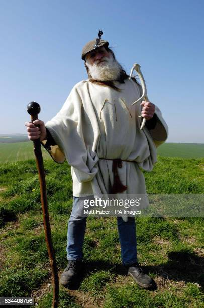 Terry Dobney a local Druid sows grass and flora seeds during a topping off ceremony on top of Silbury Hill Avebury Wiltshire to mark the success of...