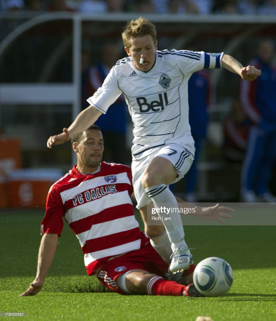 Terry Dunfield #7 of the Vancouver Whitecaps reacts after getting fouled by <a gi-track='captionPersonalityLinkClicked' href=/galleries/search?phrase=Daniel+Hernandez&family=editorial&specificpeople=2157363 ng-click='$event.stopPropagation()'>Daniel Hernandez</a> #2 of FC Dallas during the second half of MLS Soccer on April 23, 2011 at Empire Field in Vancouver, British Columbia, Canada.
